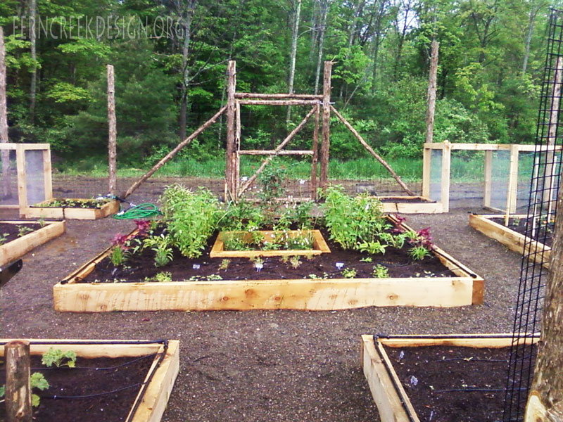Raised bed garden installation natural landscaping for Raised veggie garden designs