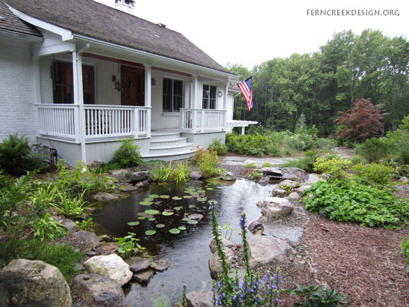 Backyard ponds and waterfalls natural landscaping for Natural garden pond design